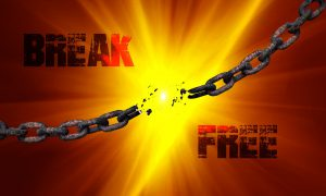 The words Break Free with a broken chain running between them on a golden background