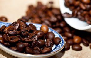 blue dish with coffee beans on it