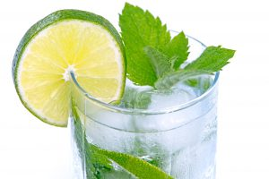Glass of water with ice, a slice of lemon and mint