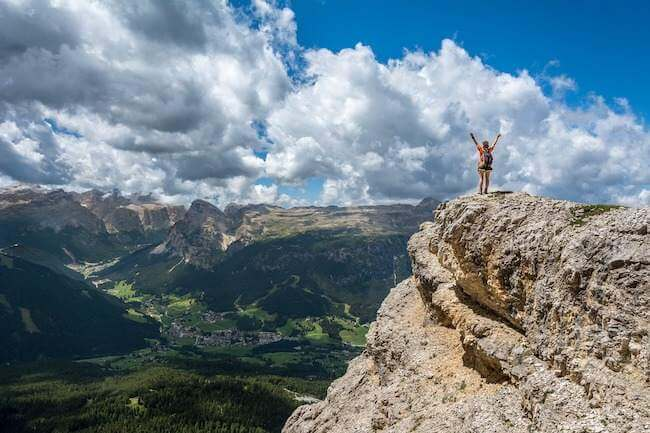 Person standing on top of a cliff