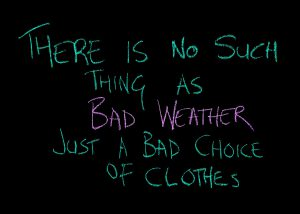 Black board with writing, there is no such thing as bad weather, just a bad choice of clothes