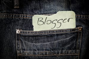 Blogger note sticking out of back jean pocket