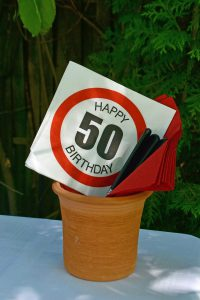 Flower pot with a 50th Happy birthday card in it