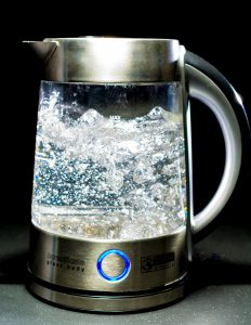 Glass kettle full of boiling water