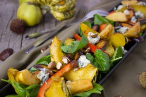 Slices of pumpkin, apple, red pepper, spinach and nuts.