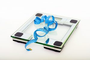 Set of modern scales and a blue tape measure