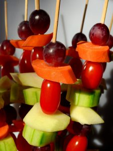 skewers with cucumber, apple, cherry tomato, carrot and grape
