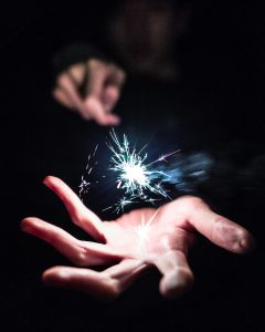 Palm of hand with sparkler held above it