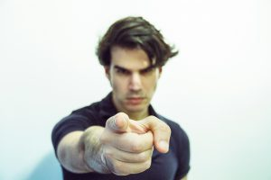 Man pointing finger accusingly